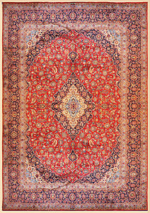 It is a 12 feet by 16 feet persian wool rug. It has a red field with beige,blue and green floral motifs.