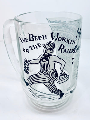 """I've Been Working On The Railroad"" Vintage Glass Mug"