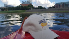 Load image into Gallery viewer, Twill Khaki Hat on boat Tennessee Aquarium in back