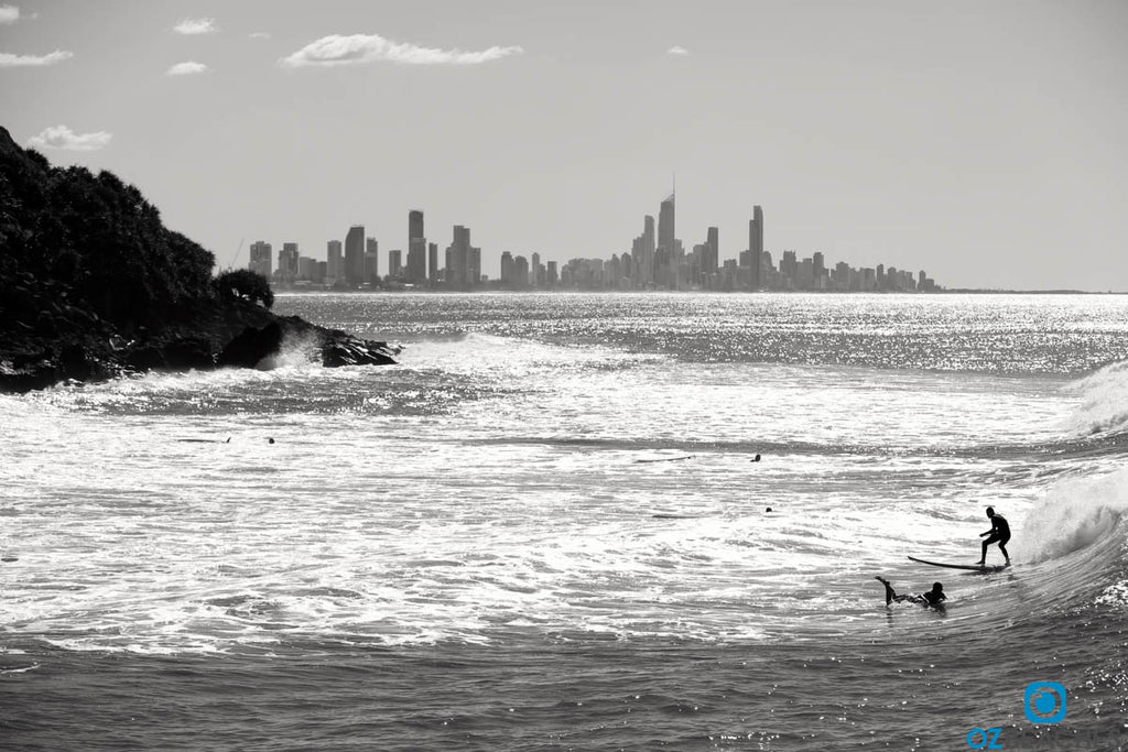 Black and white photo of people surfing at Burleigh Head