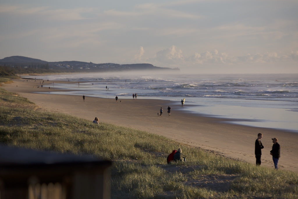 Early morning walkers at Coolum Beach Sunshine Coast QLD