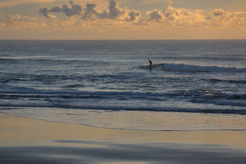 Lone surfer at Coolum Beach Sunshine Coast QLD