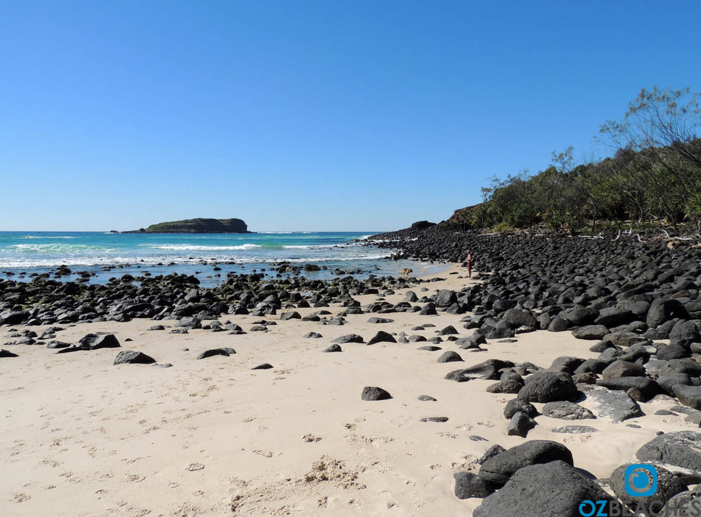 The rocky shoreline of Fingal Beach on the Tweed Coast