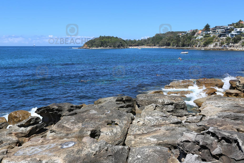 Cabbage Tree Bay is a popular place for boats and swimmers