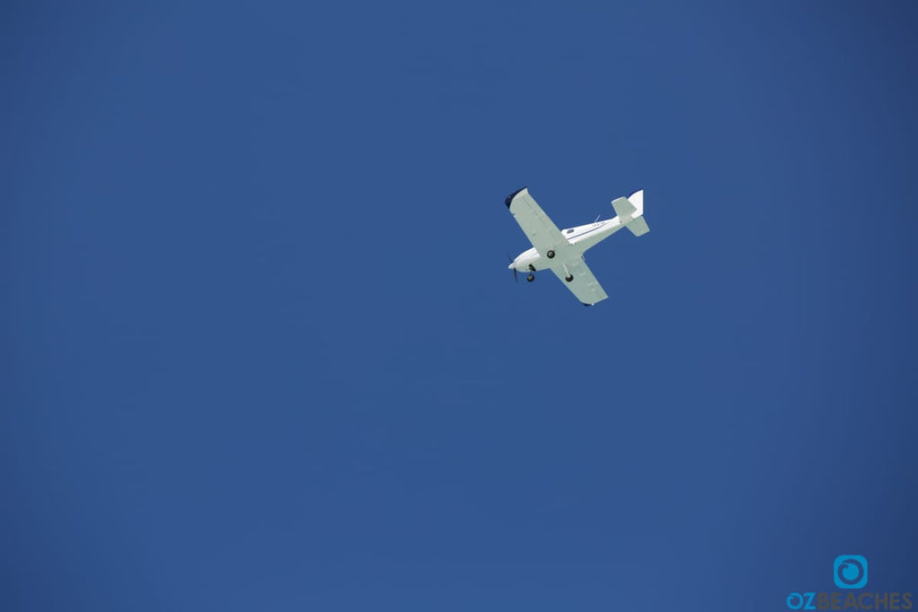 Plane flying over South Stradbroke Island