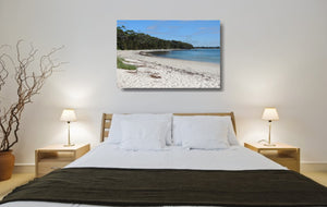 An acrylic print of a perfect sunny day at Barfleur Beach at Jervis Bay in NSW hanging in a bed room setting