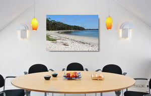 An acrylic print of a perfect sunny day at Barfleur Beach at Jervis Bay in NSW hanging in a dining room setting