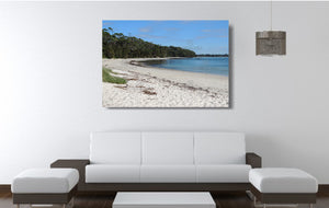 An acrylic print of a perfect sunny day at Barfleur Beach at Jervis Bay in NSW hanging in a lounge room setting