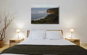 An acrylic print of a calm and overcast day at Bells Beach VIC hanging in a bed room setting