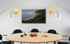 An acrylic print of a calm and overcast day at Bells Beach VIC hanging in a dining room setting