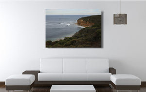 An acrylic print of a calm and overcast day at Bells Beach VIC hanging in a lounge room setting