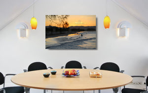 An acrylic print of a nice sunset at Belongil Beach, Byron Bay NSW hanging in a dining room setting