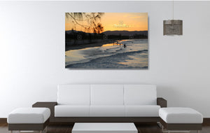 An acrylic print of a nice sunset at Belongil Beach, Byron Bay NSW hanging in a lounge room setting