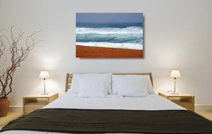 An acrylic print of seagulls against vibrant colours at Bingie Beach NSW hanging in a bed room setting