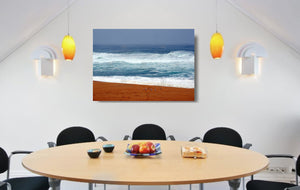 An acrylic print of seagulls against vibrant colours at Bingie Beach NSW hanging in a dining room setting