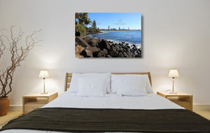 An acrylic print of a sunny day at Burleigh Heads on the Gold Coast in QLD hanging in a bed room setting