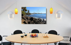 An acrylic print of a sunny day at Burleigh Heads on the Gold Coast in QLD hanging in a dining room setting