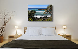 An acrylic print of Burleigh Heads on the Gold Coast, QLD hanging in a bed room setting