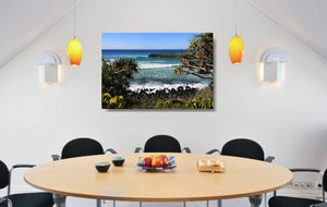 An acrylic print of Burleigh Heads on the Gold Coast, QLD hanging in a dining room setting