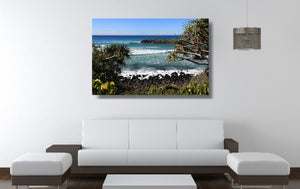An acrylic print of Burleigh Heads on the Gold Coast, QLD hanging in a lounge room setting