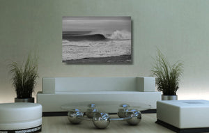 An acrylic print of a wave breaking at Sandon Point NSW hanging in a lounge room setting
