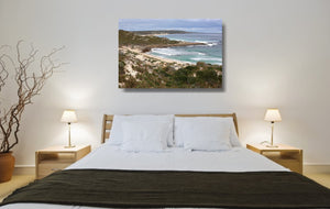 An acrylic print of Gas Bay in WA hanging in a bedroom setting