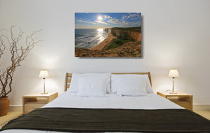 An acrylic print of the Twelve Apostles VIC hanging in a bed room setting