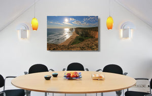 An acrylic print of the Twelve Apostles VIC hanging in a dining room setting