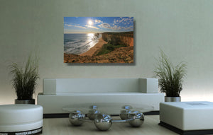 An acrylic print of the Twelve Apostles VIC hanging in a lounge room setting