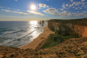 Landscape photo of the setting sun at the Twelve Apostles, Port Campbell National Park Victoria.