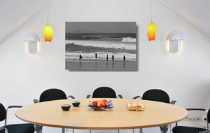 An acrylic print of Kirra Beach on the Gold Coast, QLD hanging in a dining room setting