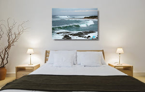 An acrylic print of the rivermouth at Margaret River in WA hanging in a bedroom setting