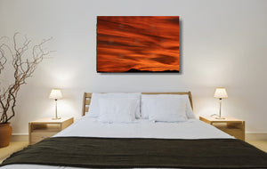An acrylic print of a lunar landscape type sunset at Paradise Point QLD in hanging in a bed room setting