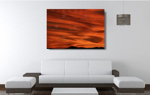 An acrylic print of a lunar landscape type sunset at Paradise Point QLD in hanging in a lounge room setting