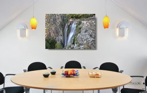 An acrylic print of Minyon Falls in NSW hanging in a dining room setting