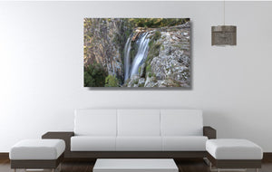 An acrylic print of Minyon Falls in NSW hanging in a lounge room setting