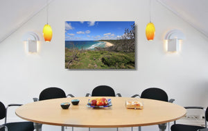 An acrylic print of Alexandria Bay at Noosa QLD hanging in a dining room setting