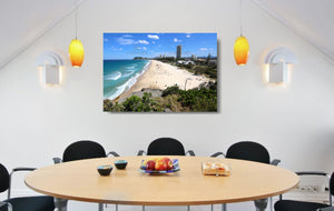 An acrylic print of North Burleigh Beach in QLD hanging in a dining room setting