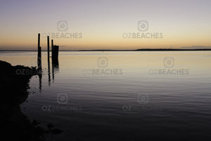 Photograph of a glassy ocean and piers at Dunwich Jetty, North Stradbroke Island QLD