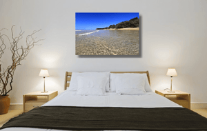 An acrylic print of the crystal clear waters of Cylinder Beach on North Stradbroke Island QLD hanging in a bed room setting