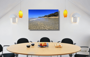 An acrylic print of the crystal clear waters of Cylinder Beach on North Stradbroke Island QLD hanging in a dining room setting