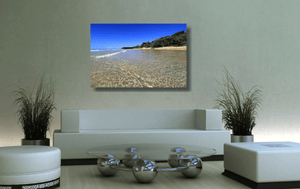 An acrylic print of the crystal clear waters of Cylinder Beach on North Stradbroke Island QLD hanging in a green lounge room setting