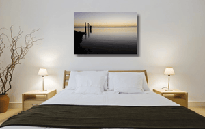 An acrylic print of sunset at Dunwich Jetty on North Stradbroke Island QLD hanging in a bed room setting