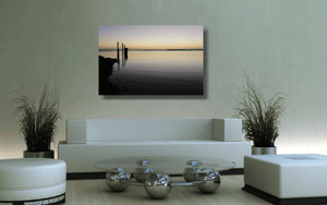 An acrylic print of sunset at Dunwich Jetty on North Stradbroke Island QLD hanging in a green lounge room setting