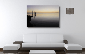 An acrylic print of sunset at Dunwich Jetty on North Stradbroke Island QLD hanging in a lounge room setting