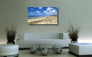 An acrylic print of Main Beach at Point Lookout on North Stradbroke Island QLD hanging in a green lounge room setting