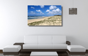 An acrylic print of Main Beach at Point Lookout on North Stradbroke Island QLD hanging in a lounge room setting