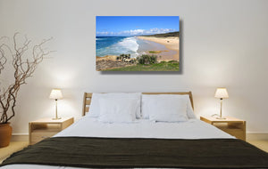 An acrylic print of Point Lookout Beach on North Stradbroke Island QLD hanging in a bed room setting