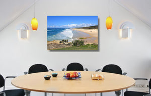 An acrylic print of Point Lookout Beach on North Stradbroke Island QLD hanging in a dining room setting