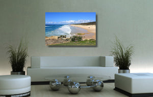 An acrylic print of Point Lookout Beach on North Stradbroke Island QLD hanging in a lounge room setting